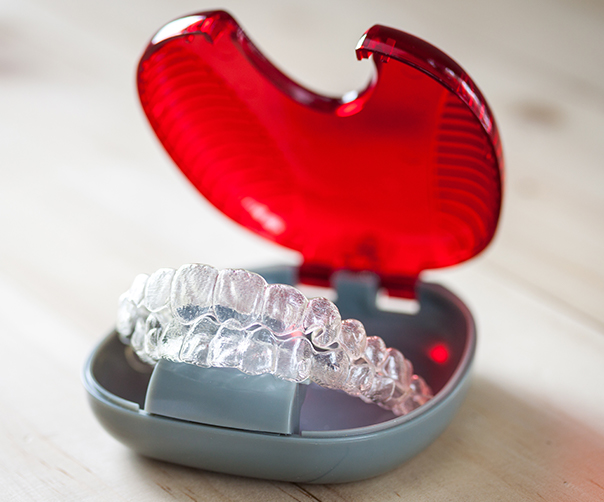 Clear Invisalign trays in carrying case