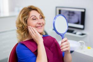 woman wearing dentures in Tyler
