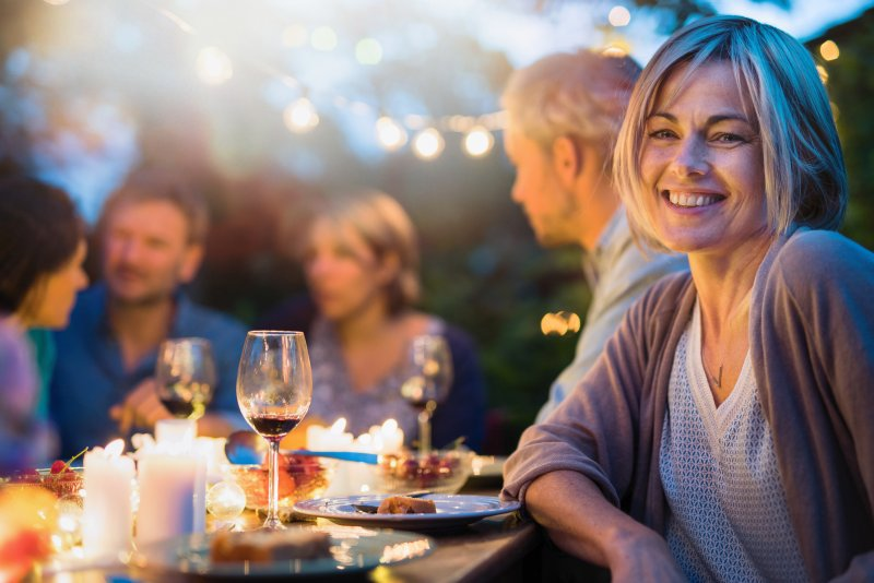 Woman having summer foods with dental implants